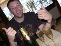 What has two thumbs and loves Champagne? This guy.