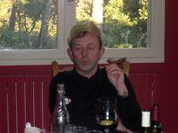 Paul enjoys a cigar